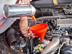 Mechanic charging oil